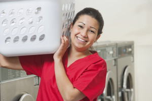 Happy Laundromat Worker Stock Photo | Getty Images